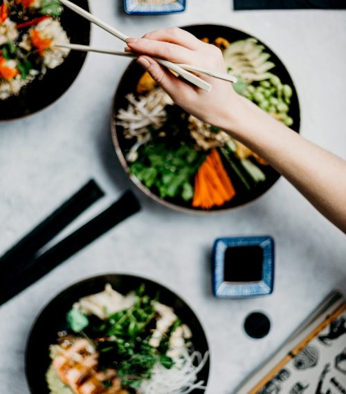 person-holding-a-wooden-chopsticks-3338542